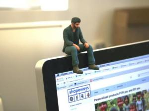 A 3D-printed miniature of Keanu Reeves, available for printing on Shapeways.